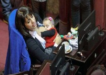 "Pic shows: Victoria Donda Perez breastfeeding his baby.  An MP gained popularity on social media after being filmed breastfeeding while on duty in Argentina.  Victoria Donda Perez ,47, was participating  in a normal session of the Argentinian Congress that she is a part of when her eight- month- old daughter Trilce got hungry.  So the MP, who is also a lawyer, decided to breastfeed her  daughter while on duty in  Buenos Aires.  It appears that Mrs Perez wanted to  set an example of both a loving mother and a hard working professional.  Activist Mrs Perez  became a Congress member in 2007 when she was nicknamed "" Dipusex ""or sexy for her curvy looks.  Supportive Juana commented on social media: ""When your baby cries, all you want is calm her down. I admire her because many mother leave their children at the nursery although breast milk is so much better than any food""  But user Zuzanne said ""All right, but she should cover her breasts with one of those special bras. You don't have to wander around showing your boobs""  (ends)"