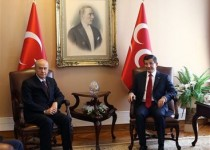 Prime Minister Ahmet Davutoglu, right, and Nationalist Movement Party, MHP, leader Devlet Bahceli during a meeting in Ankara, Turkey, Tuesday, July 14, 2015. Davutoglu met with leaders of the far-right MHP to test the waters for a coalition partnership for his Islamic-rooted ruling party. On Monday, Davutoglu held similar talks with Turkey's pro-secular Republican People's Party. As Turkey's ruling party Tuesday embarked on a second day of talks in search of a possible coalition partner, President Recep Tayyip Erdogan warned parties to keep his status out of their coalition-building efforts and said he would stand in the way of any deal that would nix his dream projects. (AP Photo / Adem Altan, Pool)