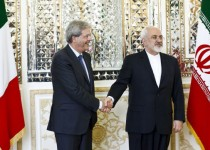 Iranian  Foreign Minister Mohammad Javad Zarif (R) shakes hands with his Italian counterpart Paolo Gentiloni before they start a meeting in Tehran