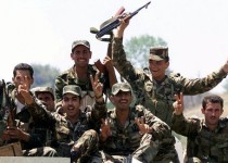 A Syrian army truck carrying troops who are give  V for victory signs at  the mountain village of Alley on their way to the eastern Bekaa valley Thursday June 14, 2001. The Syrian army has started redeploying some of its troops from Beirut's mainly Christian neighborhoods. (AP Photo/str)
