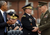 U.S. President Barack Obama applauds as outgoing chairman of the Joint Chiefs of Staff Martin Dempsey (C) shakes hands with his successor Marine Gen. Joseph Dunford (R) at his retirement ceremony at Ft. Myer in Arlington, Virginia September 25, 2015.  REUTERS/Kevin Lamarque
