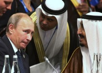 President of Russia Vladimir Putin (L) and Crown Prince Salman bin Abdulaziz Al Saud (R) of Saudi Arabia talk through their interpreters during a plenary session at the G20 leaders summit in Brisbane November 15, 2014. Western leaders attending the G20 summit blasted Putin on Saturday for the crisis in Ukraine, threatening further sanctions if Russia did not withdraw troops and weapons from its neighbouring nation. REUTERS/Rob Griffith/Pool   (AUSTRALIA - Tags: POLITICS BUSINESS ROYALS) - RTR4E8XK