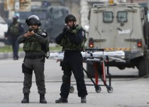 Israeli border police point their weapon as they guard at the scene where a Palestinian woman shot dead by Israeli troops in the West Bank city of Hebron November 6, 2015. The Israeli army shot dead two Palestinians on Friday, one an elderly woman accused of trying to run over soldiers in the occupied West Bank and the other a man who took part in a violent Gaza Strip protest, hospital officials said. REUTERS/Mussa Qawasma