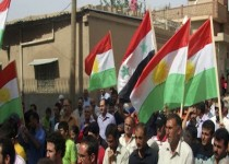 In this citizen journalism image made on a mobile phone and provided by Shaam News Network, anti-Syrian President Bashar Assad Kurds-Syrian protesters, wave their Kurdish and Syrian flag at centre as they march during a demonstration against the Syrian regime, at the Kurds-Syrian village of Amouda, in Kamishli province, Syria, on Friday, Sept. 30, 2011. Syrian security forces opened fire on protesters Friday as thousands rallied across the country to call for the downfall of President Bashar Assad's regime, activists said. (AP Photo/Shaam News Network) EDITORIAL USE ONLY, NO SALES, THE ASSOCIATED PRESS IS UNABLE TO INDEPENDENTLY VERIFY THE AUTHENTICITY, CONTENT, LOCATION OR DATE OF THIS HANDOUT PHOTO