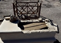 A tomb looted by grave robbers in the cemetery of the Puelma nitrate camp  in the outskirts of Antofagasta, Chile on June 15, 2015. The history of the nitrate came to an end in 1930 when the synthetic nitrate substituted the mineral nitrate by converting these populations exposed to high levels of pollution in ghost towns and becoming historical monuments.  AFP PHOTO/ Yuri CORTEZ        (Photo credit should read YURI CORTEZ/AFP/Getty Images)