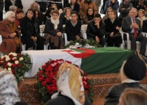 Mourners including the mother (2L) and sister (3L) of French-language author and film-maker Assia Djebar pay their respects at the Palace of Culture in Algiers the day before her funeral in her native home town of Cherchell, a Berber coastal town west of Algiers on February 12, 2015. Djebar, who was an ardent defender of women's rights in her native Algeria, died the day before in a hospital in Paris. AFP PHOTO / FAROUK BATICHE