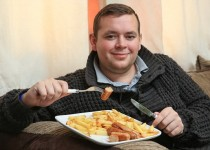 "Daniel Pennock who has a bizarre diet disorder where he eats sausage and chips for dinner - EVERY DAY. See SWNS story SWBANGER;  A dad-of-two is begging for help to cure his eating disorder which has seen him eat sausage and chips for dinner every day - for 22 YEARS. Daniel Pennock, 26, ate a varied diet as a toddler but at the age of four stopped tucking into all other foods - apart from bangers and fries - for his evening meal. He claims to be physically sick when any other foods - apart from bread, crisps, apples, bananas and sausage rolls - come anywhere near his lips. The unusual habit has seen him pile on the pounds and cost him relationships with former girlfriends who got fed-up because he has NEVER eaten out. But the lifeguard - who wants to become a personal trainer - is begging for professional help to tackle his limited diet so he can live a ""normal"" life."