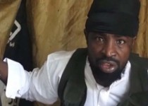 """A screengrab taken on March 24, 2014 from a video obtained by AFP shows a man claiming to be the leader of Nigerian Islamist extremist group Boko Haram Abubakar Shekau. Boko Haram has claimed responsibility for an attack on a key military barracks in Nigeria, in a new video obtained on March 24, 2014 by AFP that warns of further bloodshed, including against civilians.  The man appeared younger, thinner and with different mannerisms from older videos, which could prompt fresh questions about whether the militant leader, who had previously been reported killed, is still alive. RESTRICTED TO EDITORIAL USE - MANDATORY CREDIT """"AFP PHOTO / BOKO HARAM"""" - NO MARKETING NO ADVERTISING CAMPAIGNS - DISTRIBUTED AS A SERVICE TO CLIENTSHO/AFP/Getty Images"""