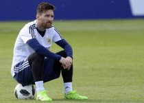 Argentina's forward Lionel Messi looks on as he sits on a ball during a training session of Argentina's national football team at the team's base camp in Bronnitsy, near Moscow, on June 11, 2018 ahead of the Russia 2018 World Cup football tournament. / AFP PHOTO / JUAN MABROMATA