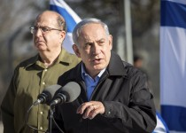 """Israel's Prime Minister Benjamin Netanyahu stands with Defence Minister Moshe Yaalon (L) as he delivers a statement during a visit to an army base near the Etzion bloc of Jewish settlements in the West Bank November 23, 2015. Critics say Netanyahu, known as """"Bibi,"""" is hitting the wrong note when it comes to the media, weakening press freedom and holding sway over TV broadcasters in a country that bills itself as the Middle East's only true democracy. To match Insight ISRAEL-NETANYAHU/MEDIA REUTERS/Emil Salman/Haaretz/Pool"""
