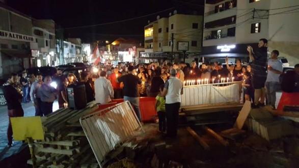وقفة رمزية في البترون وإضاءة شموع على نية لبنان