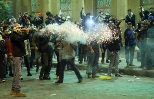 Protesters clash with riot police for second day