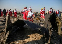 Red Crescent workers check the debris from the Ukraine International Airlines plane, that crashed after take-off from Iran's Imam Khomeini airport, on the outskirts of Tehran, Iran January 8, 2020. Nazanin Tabatabaee/WANA (West Asia News Agency) via REUTERS ATTENTION EDITORS - THIS IMAGE HAS BEEN SUPPLIED BY A THIRD PARTY