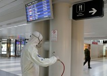 An employee of a private company sprays the interior of the Lebanese capital Beirut's Rafiq Hariri international airport with disinfectant, to limit the spread of the Covid-19 coronavirus, on March 18, 2020. (Photo by ANWAR AMRO / AFP) (Photo by ANWAR AMRO/AFP via Getty Images)